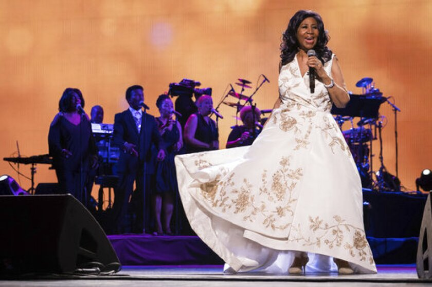 """FILE - This April 19, 2017 file photo shows Aretha Franklin performing at the world premiere of """"Clive Davis: The Soundtrack of Our Lives"""" at Radio City Music Hall in New York. A previously unreleased Franklin recording of """"O Tannebaum"""" will be released as part of the holiday album """"Big Band Holidays II"""" from the Jazz at Lincoln Center Orchestra with Wynton Marsalis. (Photo by Charles Sykes/Invision/AP, File)"""