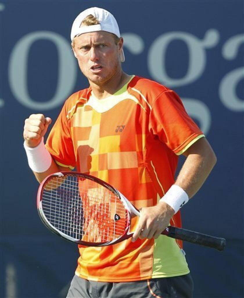 Australia's Lleyton Hewitt reacts during his match against Gilles Miller of Luxemborg, in the third round of play at the 2012 US Open tennis tournament,  Friday, Aug. 31, 2012, in New York. (AP Photo/Mel C. Evans)