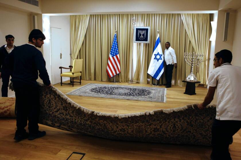 Workers prepare the residence of Israeli President Shimon Peres, one of the officials President Obama will meet with in Jerusalem.