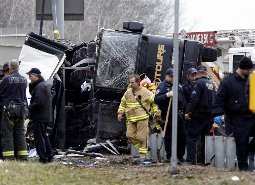 Emergency personnel investigate the scene of a bus crash in the Bronx borough of New York in March 2011.