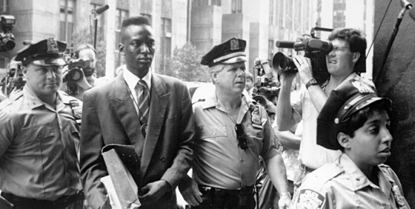 Yusef Salaam, one of the Central Park Five, is escorted by police in New York in 1990.