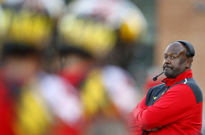 Maryland interim head coach Mike Locksley watches from the sideline in the second half of an NCAA college football game against Indiana, Saturday, Nov. 21, 2015, in College Park, Md. Indiana won 47-28. (AP Photo/Patrick Semansky)