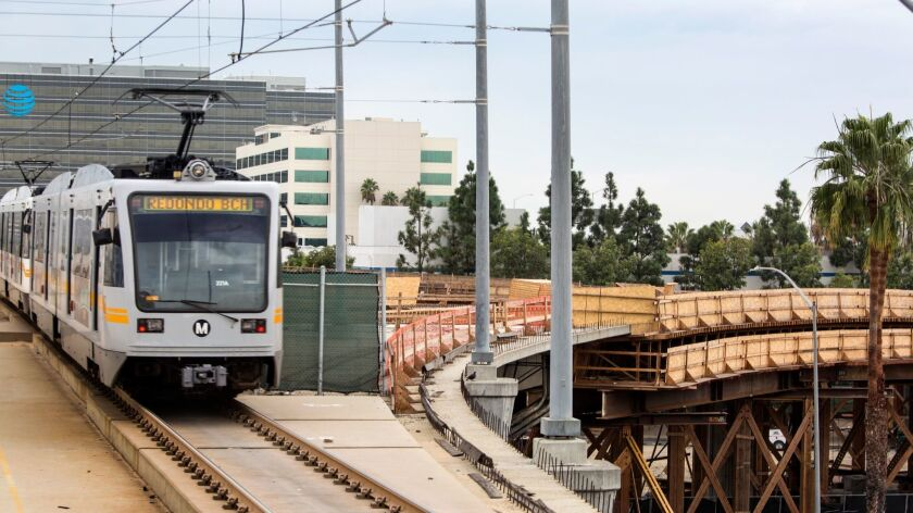 A Metro Green Line train passes by a transit line under construction.