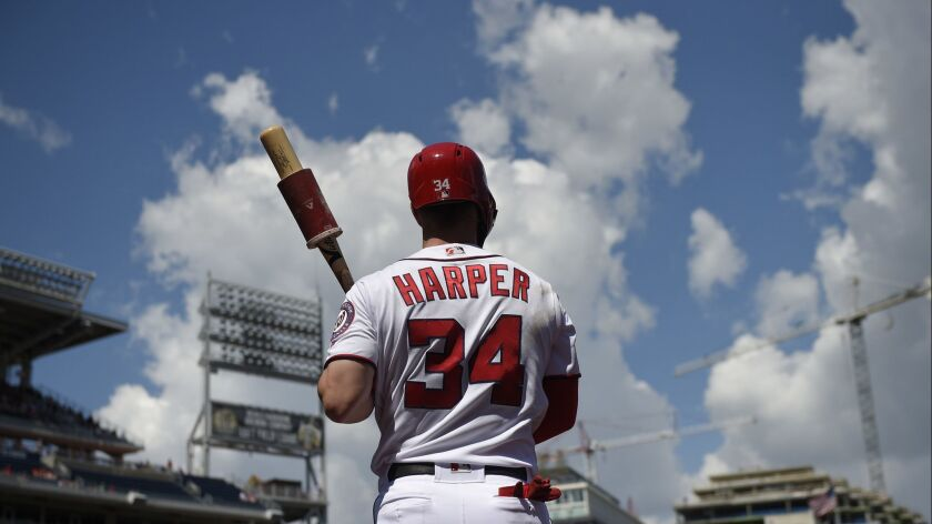 Washington Nationals' Bryce Harper stands on the on deck circle during the first inning of a basebal