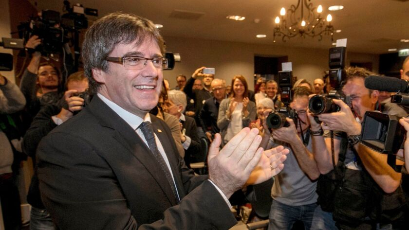 FILE - In this Saturday, Nov. 25, 2017 file photo, ousted Catalan president Carles Puigdemont attend