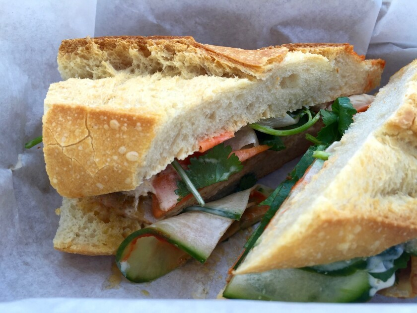 Take time to support your favorite local restaurants by ordering takeout or buying gift cards. The Steve Julian sandwich, shown here, is Wax Paper's take on the banh mi. The sandwich is stuffed with roasted pork loin, pickled carrots and daikon with a miso-and-bacon fat aioli and served on a baguette.