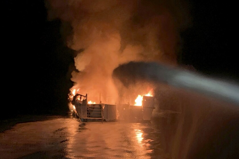 FILE - In this Sept. 2, 2019, file photo provided by the Ventura County Fire Department, VCFD firefighters respond to a fire aboard the Conception dive boat fire in the Santa Barbara Channel off the coast of Southern California. Family members of the 34 people killed in a fire aboard a scuba diving boat off the California coast two years ago have sued the U.S. Coast Guard for lax enforcement of safety regulations. The lawsuit filed late Wednesday, Sept. 1, 2021, says the Coast Guard has repeatedly certified passenger boats that are fire traps. (Ventura County Fire Department via AP, File)