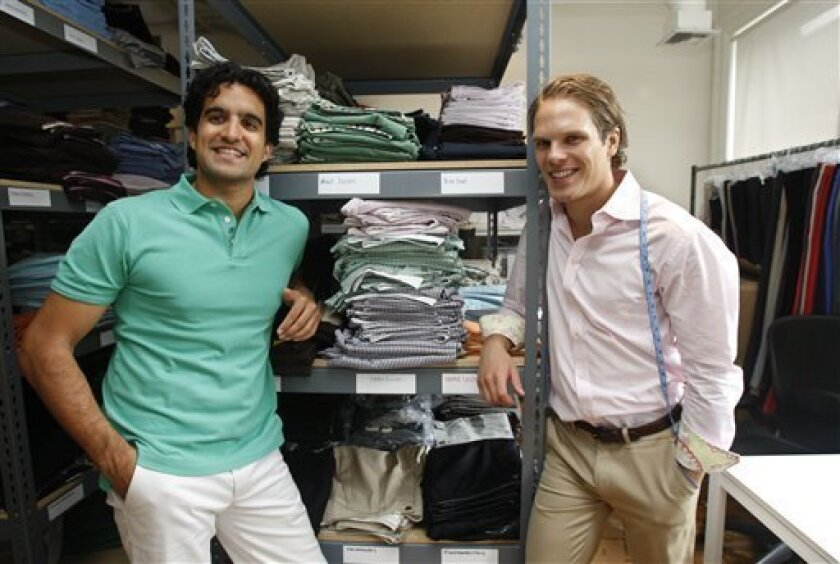 In this photo made Thursday, Sept. 17, 2009, Bonobos online trousers CEO and co-founder Andy Dunn, left, and chairman and co-founder Brian Spaly pose at their company's headquarters in New York. (AP Photo/Kathy Willens)