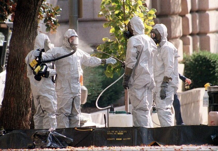 A hazmat worker is hosed off on Capitol Hill in October 2001 after anthrax-laced letters were sent to two senators.
