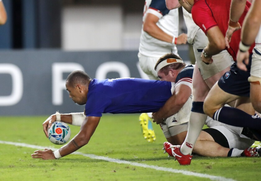 France's Gael Fickou scores a try during the Rugby World Cup Pool C game at Fukuoka Hakatanomori Stadium between France and the United States in Fukuoka, Japan, Wednesday, Oct. 2, 2019. (AP Photo/Christophe Ena)