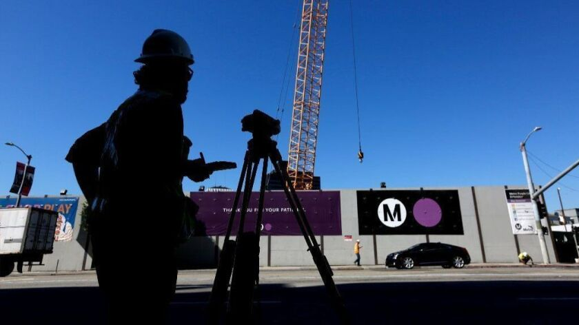 Construction of the Metro Purple Line subway extension takes place at the corner of Wilshire Boulevard and La Brea Avenue in 2016.