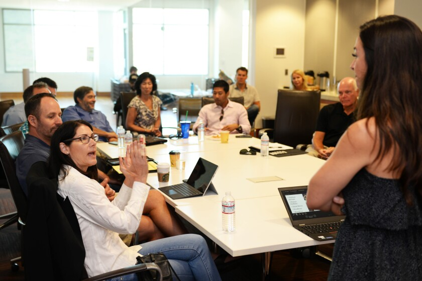 Investors at San Diego's chapter of Tech Coast Angels (TCA) discuss strategy and investments at a meeting. TCA led Atlazo's recent seed round in one of the angel group's biggest investments to date.
