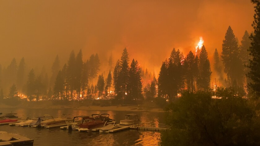 The Creek fire exploded and surrounded Shaver Lake in California, seen here on Sept. 6.