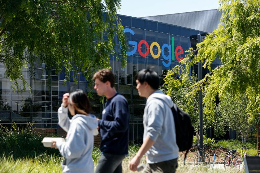 People walk in Google's main campus as a sit-in.