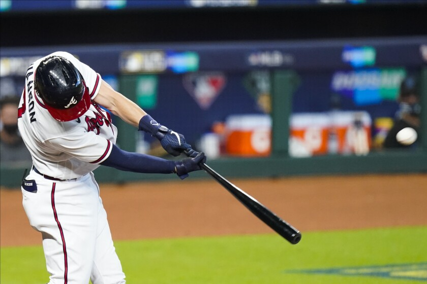 Atlanta Braves' Dansby Swanson hits a home run during the second inning in Game 2 of a baseball National League Division Series against the Miami Marlins Wednesday, Oct. 7, 2020, in Houston. (AP Photo/Eric Gay)