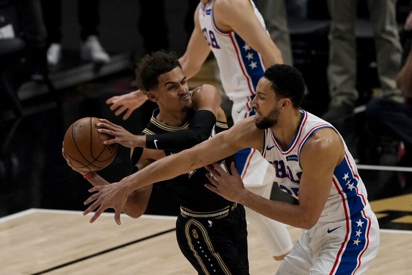 76ers forward Ben Simmons tries to steal the ball from Hawks guard Trae Young during a game last season.