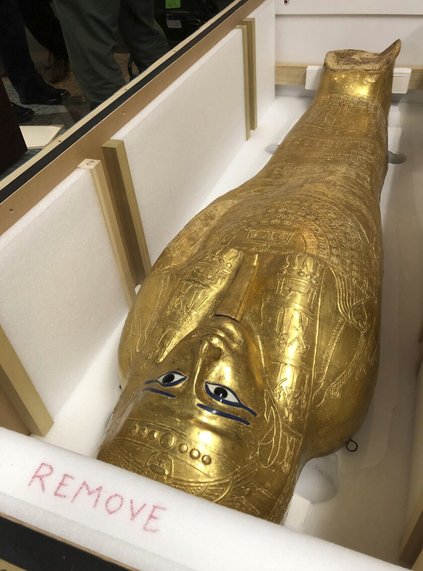 The Coffin of Nedjemankh is shown in a crate on Wednesday, Sept. 25, 2019 in New York, before it is returned to Egypt. The gilded coffin that was featured at New York's Metropolitan Museum of Art is on its way back to Egypt after it was determined to be a looted antiquity. (AP Photo/Michael R. Sisak)