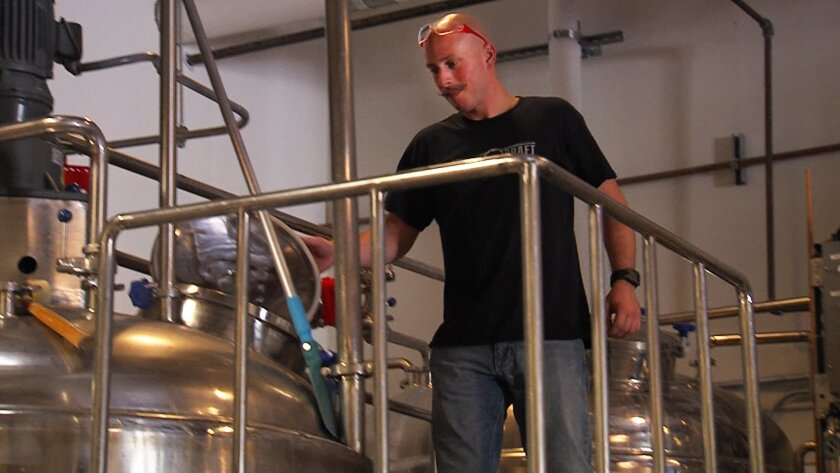 Alex Rabe, Head Brewer at Rough Draft of Mira Mar, at work on Friday, Oct. 4, 2013
