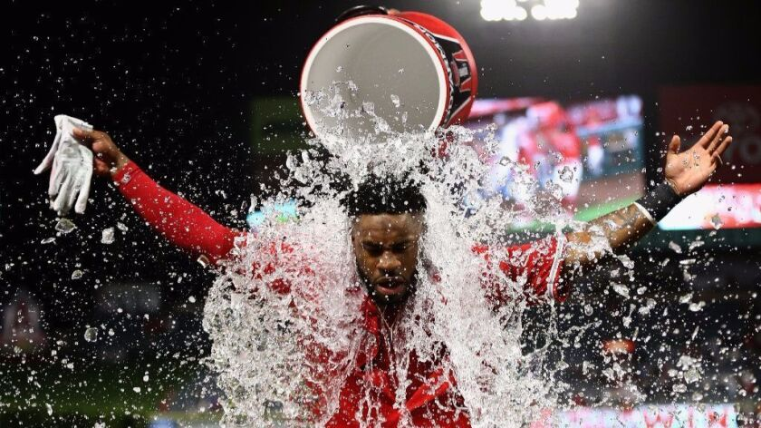 Angels outfielder Eric Young Jr. receives an icebath after driving in the game-winning run against t