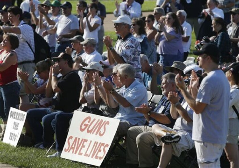 Participants applaud during a rally to override Gov. Jay Nixon's veto of a gun bill on the south lawn of the Missouri State Capital in Jefferson City, Mo., Wednesday, Sept. 11, 2013. The governor vetoed a bill that attempted to nullify certain federal gun laws. (AP Photo/Orlin Wagner)