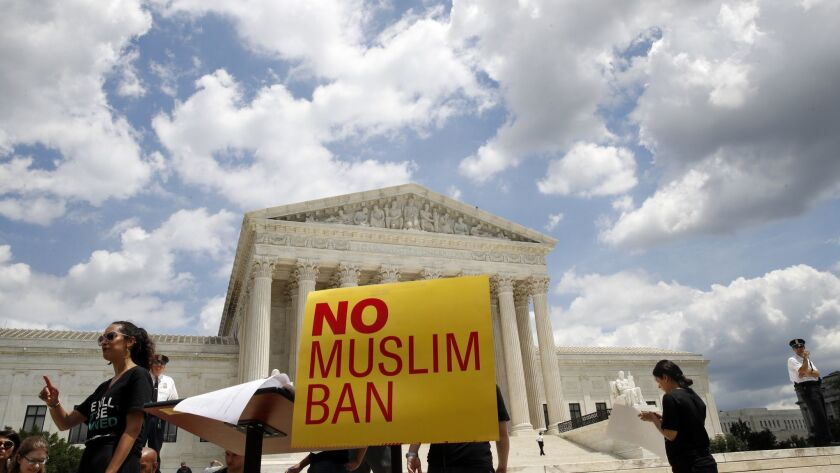 People protest against the Supreme Court ruling upholding President Donald Trump's travel ban outsid