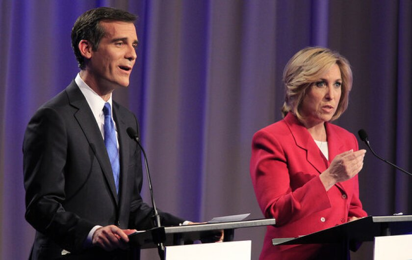 Los Angeles mayoral candidates Eric Garcetti and Wendy Greuel square off in a debate at USC's Health Sciences Campus.