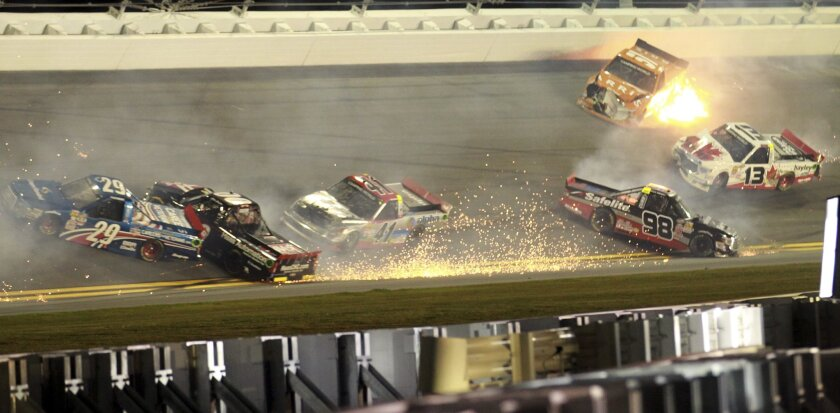 Drivers Tyler Reddick (29), Cole Custer (00), Ben Rhodes (41), Rico Abreu (98), Cameron Hayley (13), and Daniel Suarez (51) crash during the NASCAR Truck Series auto race at Daytona International Speedway in Daytona Beach, Fla., Friday, Feb. 19, 2016. (AP Photo/John Chilton)
