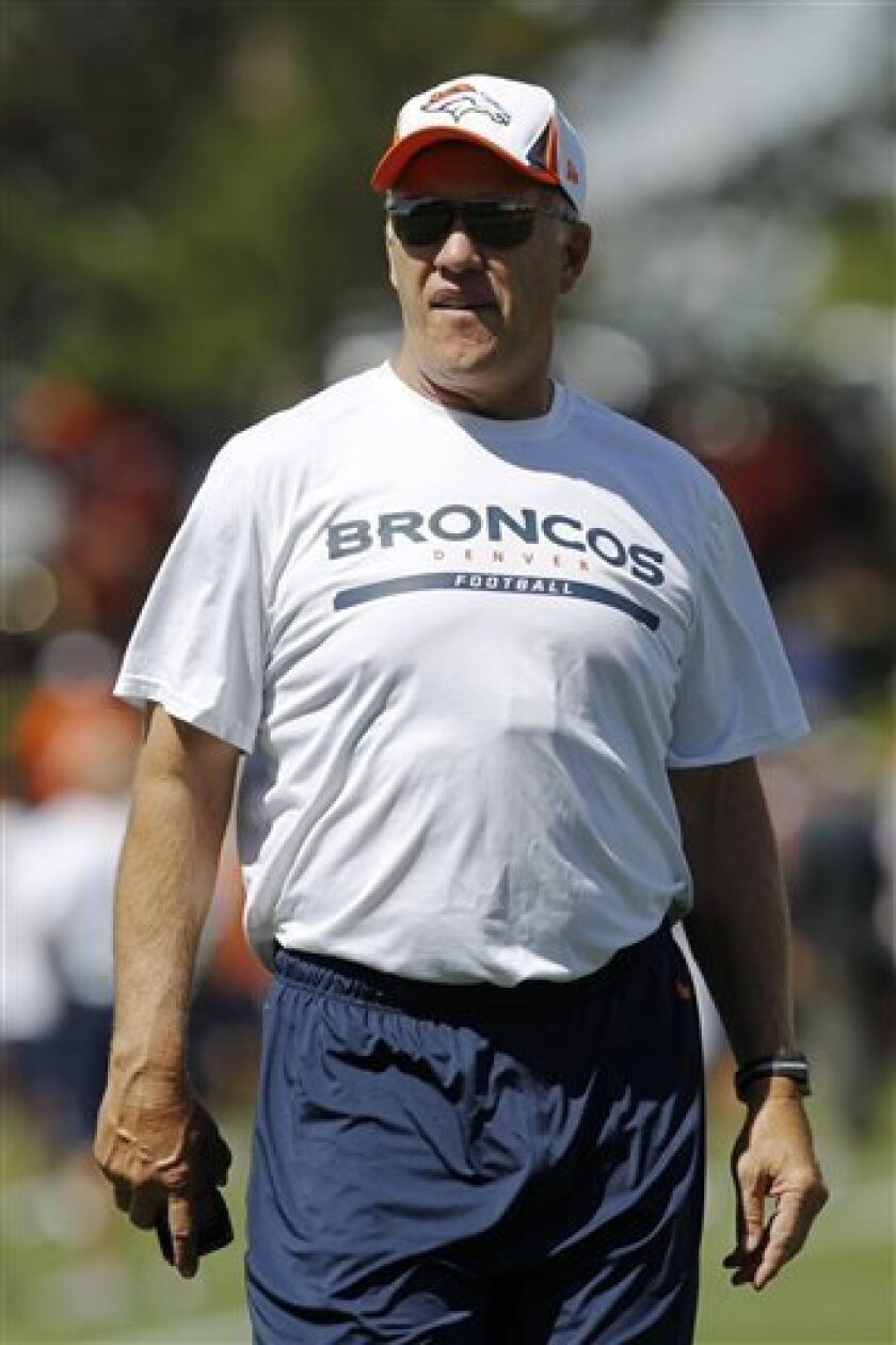 Denver Broncos executive vice pesident of football operations John Elway heads off the field after watching the morning session at the team's NFL training camp in Englewood, Colo., on Tuesday, Aug. 6, 2013. (AP Photo/David Zalubowski)