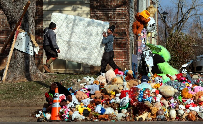 A resident of the Canfield Green apartments in Ferguson, Mo., who lived right above the spot where Michael Brown was killed, moved out on Nov. 19 in advance of a St. Louis county grand jury decision.