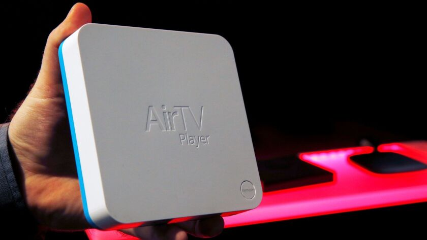 An AirTV, from Dish, is displayed at CES on January 6, 2017. The Android-based streaming device allows Sling customers to add local broadcast stations into their guide using an external antenna.