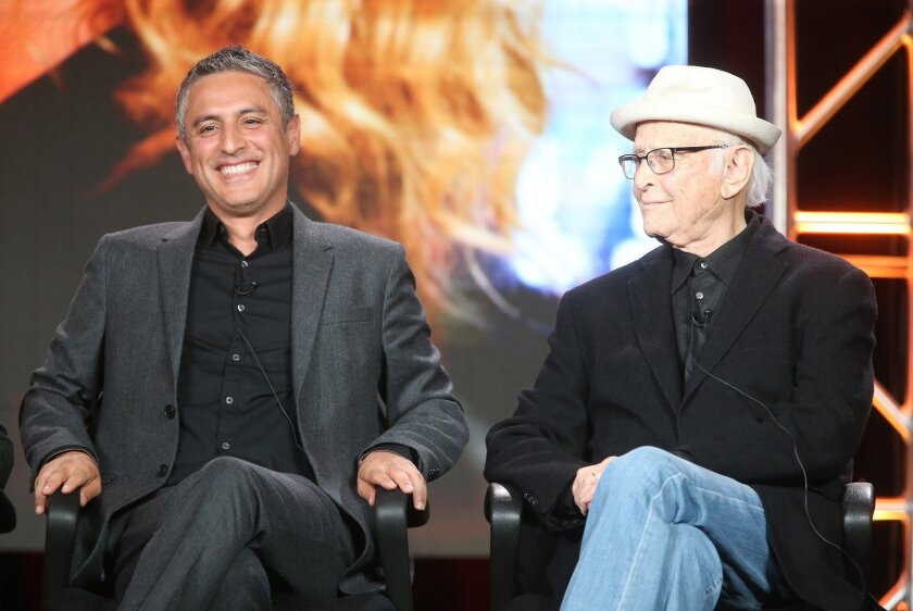 """Reza Aslan, left, host of """"Rough Draft,"""" speaks during the 2016 TCA Press Tour with writer Norman Lear alongside."""