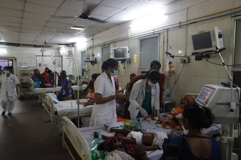 Children suffering from various ailments and their relatives crowd a ward at the Sarojini Naidu Childrens Hospital, in Prayagraj, Uttar Pradesh, India, Monday, Sept. 6, 2021. The annual monsoon season brings a spurt in mosquito-borne diseases overcrowding hospitals in most parts of India. (AP Photo/Rajesh Kumar Singh)