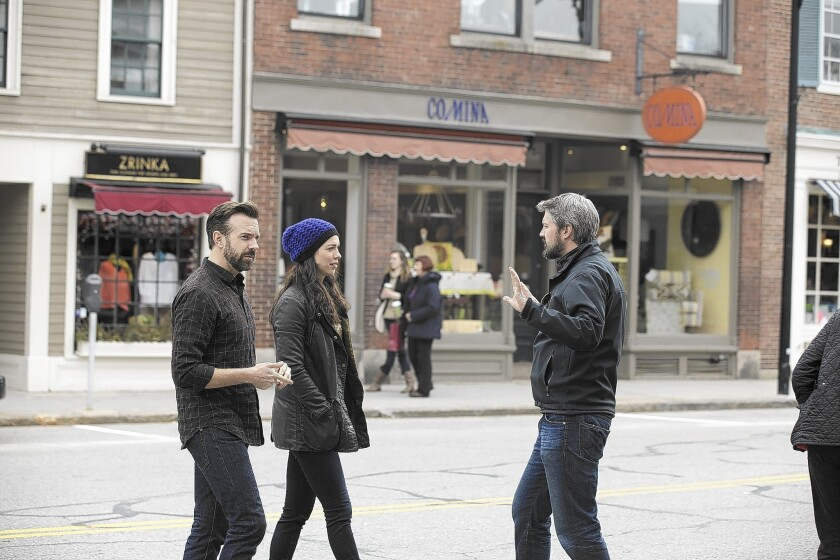 """Tumbledown"" stars Jason Sudeikis, left, and Rebecca Hall talk with director Sean Mewshaw during a film shoot in Concord, Mass. The indie movie's budget was roughly $4 million."