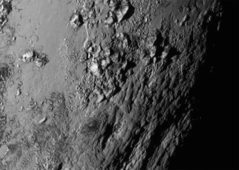 New close-up images of a region near Pluto's equator reveal a giant surprise -- a range of youthful mountains rising as high as 11,000 feet.