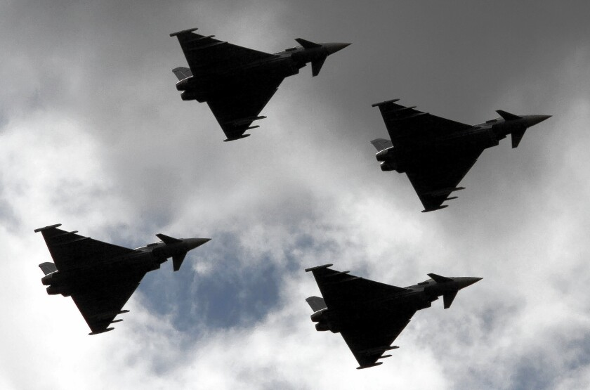 """Four """"Eurofighters"""" fly over Rostock, Germany, in August. Germany participates in NATO air surveillance begun in reaction to the crisis in Ukraine."""