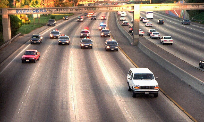 In this June 17, 1994, photo, a white Ford Bronco, driven by Al Cowlings carrying O.J. Simpson, is trailed by Los Angeles police cars as it travels on a Southern California freeway in Los Angeles.