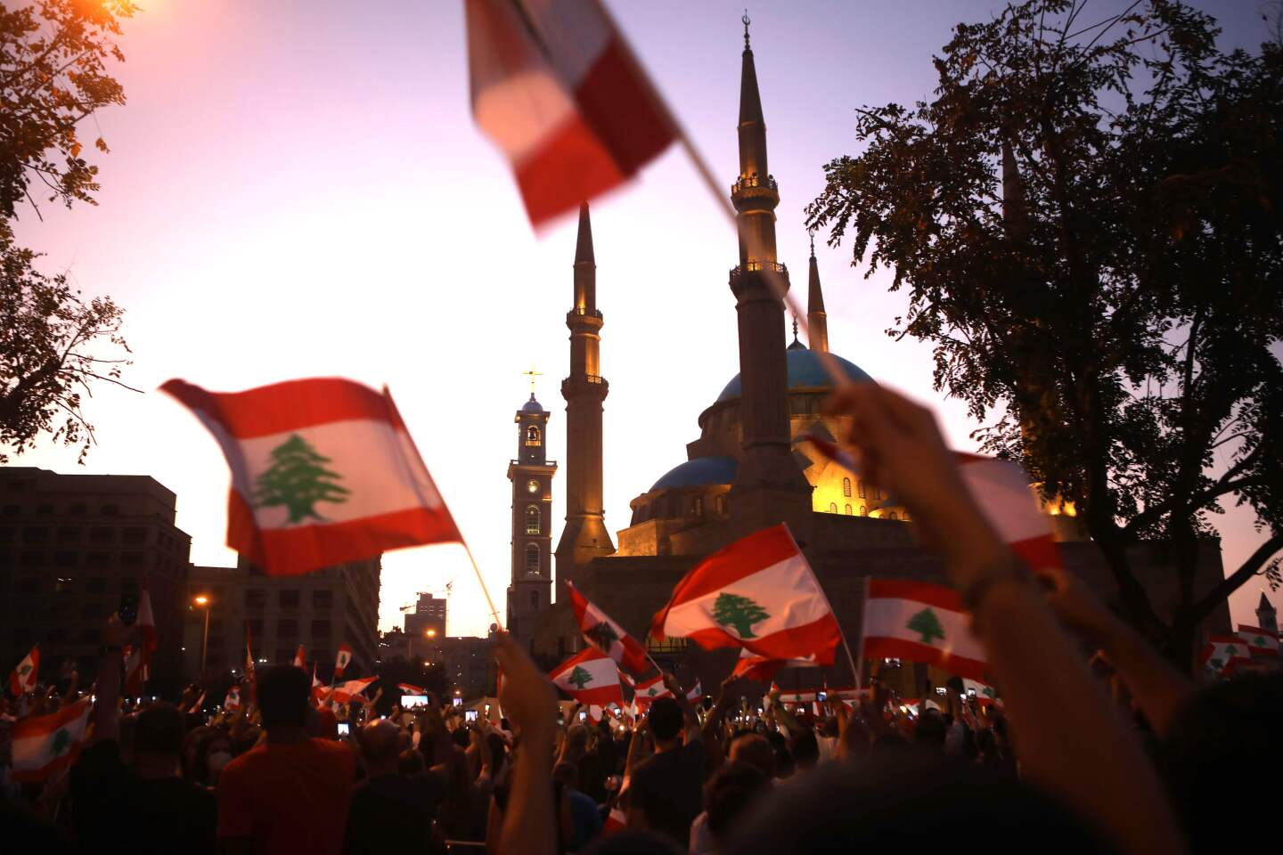 Lebanese demonstrators wave national flags as they take part in a protest in the capital Beirut, outside the Mohammad al-Amin mosque in the downtown district's Martyr's Square on October 19, 2019. - Tens of thousands of Lebanese people took to the streets today for a third day of protests against tax increases and alleged official corruption despite several arrests by security forces. (Photo by Patrick BAZ / AFP) (Photo by PATRICK BAZ/AFP via Getty Images) ** OUTS - ELSENT, FPG, CM - OUTS * NM, PH, VA if sourced by CT, LA or MoD **