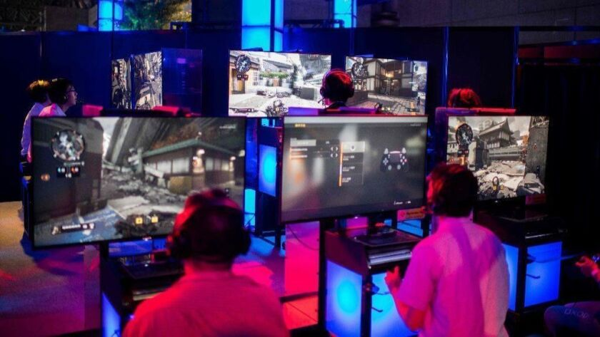 """Attendees play """"Call of Duty"""" at the Tokyo Game Show on Sept. 21, 2018. U.S. officials have vowed to investigate in-game """"loot boxes"""" used by many video games."""