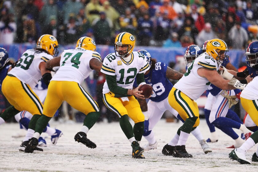 Green Bay Packers quarterback Aaron Rodgers looks to hand off the ball.