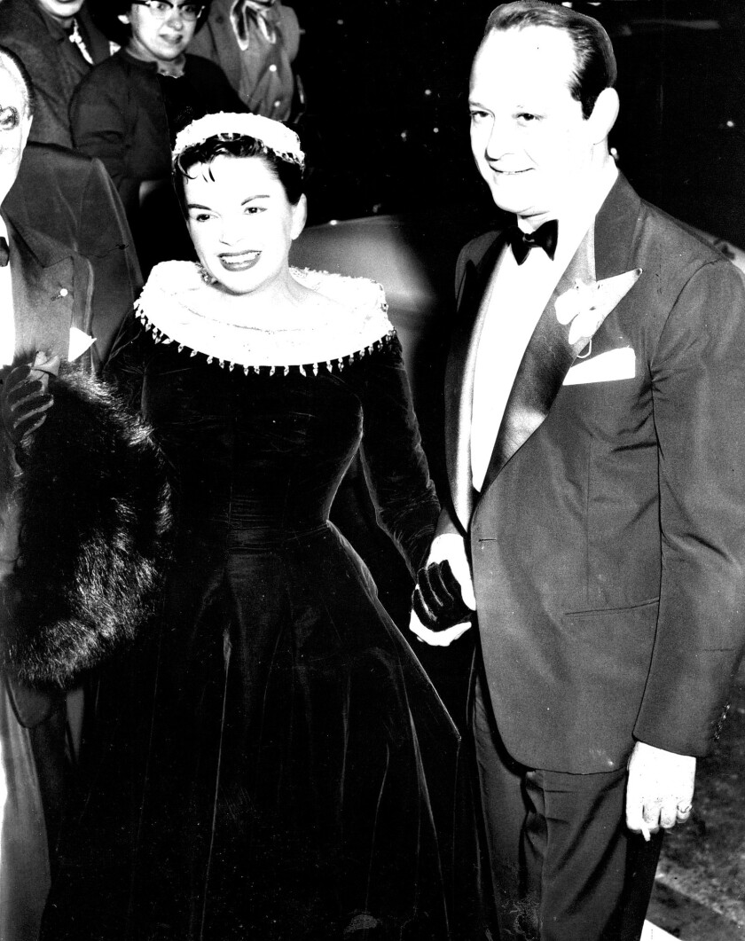 "1954 file photo of Judy Garland and her husband, Sid Luft, arriving for the world premiere of ""A Sta"