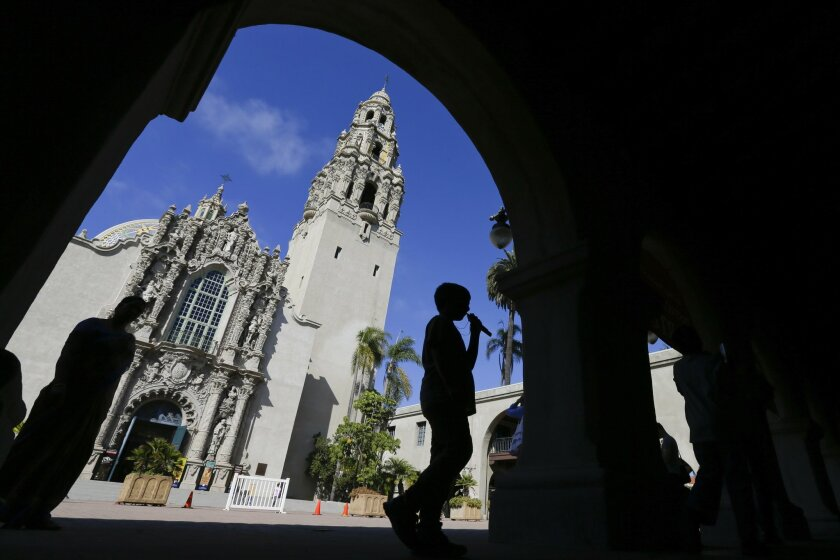 FILE - In this Oct. 2, 2013, file photo, a boy walks past a building in Balboa Park in San Diego. Balboa Park will be marking its 100th anniversary in 2015 with a host of festivities, although any day is worth a visit to the 1,200-acre urban oasis that rivals New York's Central Park and is home to the San Diego Zoo. (AP Photo/Gregory Bull, File)