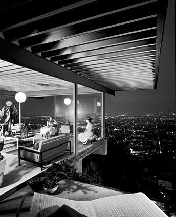 """By Barbara Thornburg Case Study House No. 22 may be one of the most photographed homes in the world. Julius Shulman took this iconic shot of the house on the warm evening of May 9, 1960. The two young women seen chatting, Cynthia Tindle and Ann Lightbody, were not the owners but students whom Shulman recruited to be models. All the furnishings were staged for the shoot, supplied by furniture firm Van Keppel-Green – but only temporarily. """"My mom told me she wished they would have left the furniture,"""" says Shari Stahl Gronwald, who grew up in the home. It was all part of the editor of Art & Architecture magazine's Case Study House program to promote modernism. Many of the owners received cost breaks on building materials in exchange for allowing photos to run in the magazine. They were also required to open their doors to the public for a month. Read the full story on growing up in Case Study House No. 22. Back to L.A. at Home"""