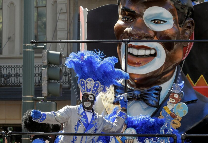 Zulu rolls down St. Charles Avenue toward Canal Street in the New Orleans CBD Tuesday, Feb. 9, 2016.  Dressed in elaborate costumes, dancing to the beat of brass bands and clamoring for beads from passing floats, thousands of people gathered in the streets of New Orleans to mark the culmination of