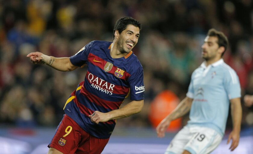 In this Sunday, Feb. 14, 2016 photo, FC Barcelona's Luis Suarez celebrates after scoring during a Spanish La Liga soccer match between FC Barcelona and Celta Vigo at the Camp Nou stadium in Barcelona, Spain. Lionel Messi put on another show at the Camp Nou on Sunday, scoring a remarkable goal from