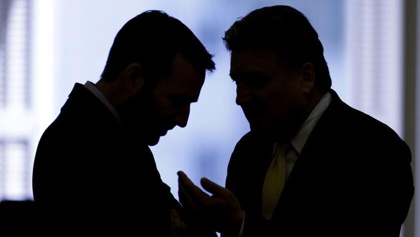 Democratic state Sens. Ben Allen, of Santa Monica, left, and Robert Hertzberg, of Van Nuys, huddle d