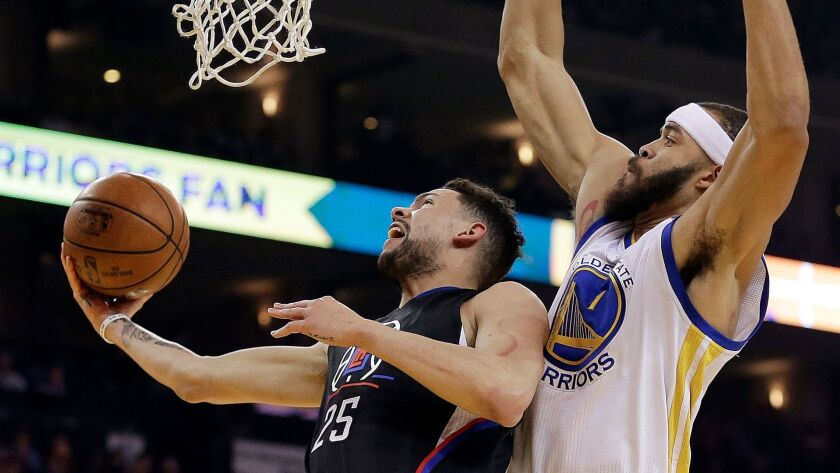 Austin Rivers, left, drives against Golden State's JaVale McGee on Feb. 23.