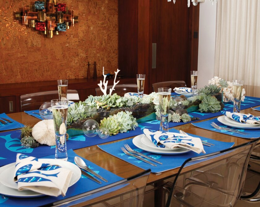 A centerpiece of succulents designed by Britt Neubacher and Wabisabi Green's Blue Fish table linens create a retro New Year's Eve setting.