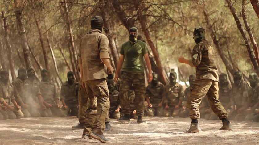 "Ahrar al-Sham a Syrian rebel group, trains in Syria's northern Aleppo as seen in the documentary ""He"