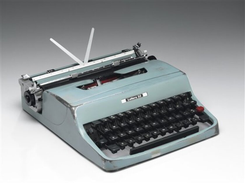 "This undated photo provided by Christie's in New York shows the Olivetti manual typewriter on which author Cormac McCarthy typed all of his novels from 1958 to 2009, including ""The Road"" and ""No Country for Old Men."" The typewriter and its original blue carrying case was sold at auction by Christie"