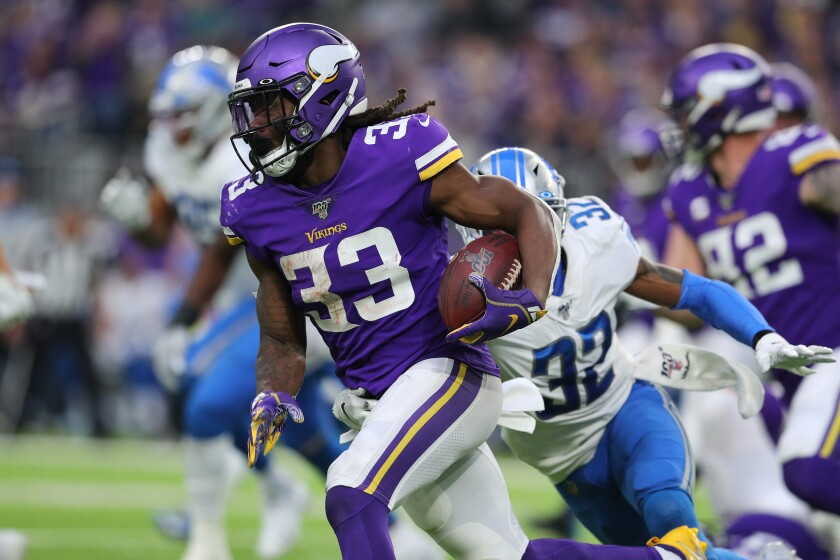 Vikings running back Dalvin Cook carries the ball against the Lions on Dec. 8, 2019.